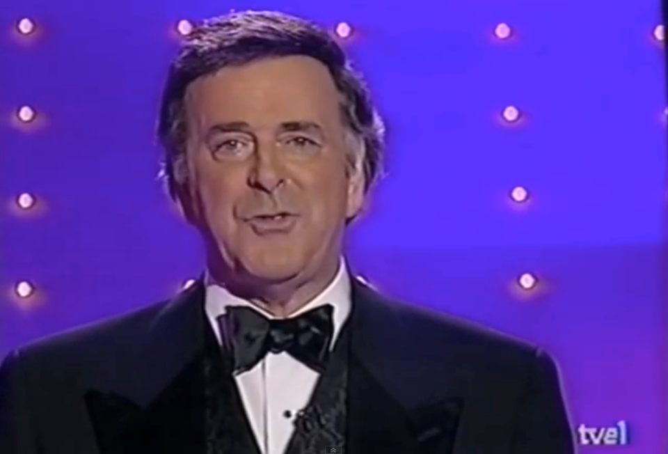 Terry wogan presenting Eurovision 1998, that was held in UK Birmingham
